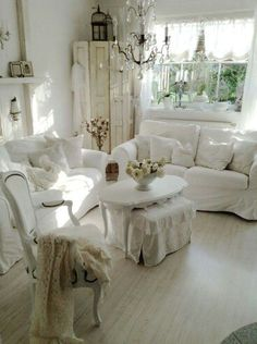 Lovely shabby sitting room. Love the wrought iron chandelier!