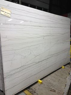 """Brazilian quartzite that is as durable as granite looks more like marble but will not stain like marble."""