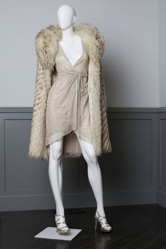 Need this dress.  - Costume design by Michael Wilkinson. Sheer platinum lame disco dress, worn by Amy Adams in scene at Studio 54. Made for the film. Vintage knee length fur with shawl collar.  Badgley Mischka disco-inpsired strappy stilettos