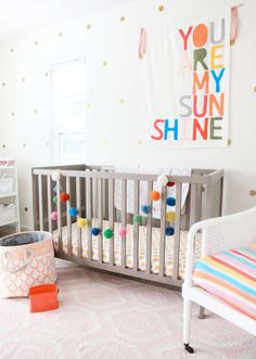 10 Baby Girl Nursery Ideas - rainbow colours keep a baby girls room cute without being too gender stereotypical!