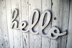 22 inch wooden hello wall sign. $39.00, via Etsy.