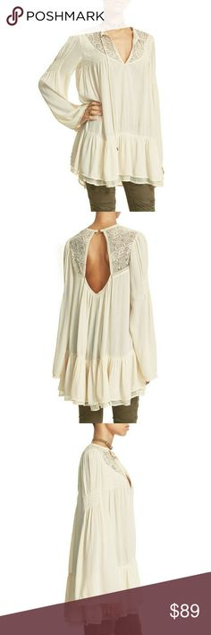 New FREE PEOPLE Victorian Lace Tunic Top Delicate lace insets put an extra-feminine touch on a light and easy Victorian-inspired tunic, styled with sultry cutout at back and a ruffle double-layer hemline.  Color: Ivory  Long bells sleeves with detailing  Embroidery, crochet lace and mesh inset at yoke  Cutout at back  Double-layer ruffled hem  Pullover style; ties at neck  Unlined  Rayon/nylon/polyester  Approximately 31 inches in length  Dry clean or hand wash  Retails for $128 Free People…