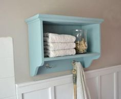 Simple woodworking plans to help you build a Bath Storage Shelf with robe hooks designed to store towels and other bathroom supplies. Featuring two cubbies, top shelf storage with protective ledge and two hooks, these beginning woodworking plans will help any do it yourself newbie build a Pottery Barn Matilda Wall Storage inspired bath storage.