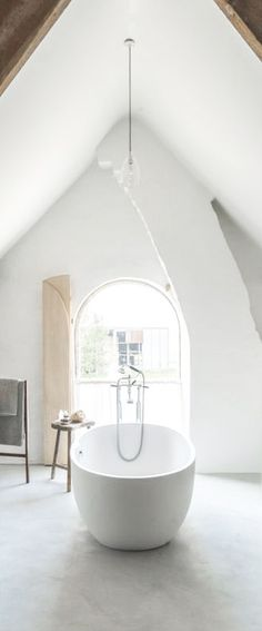 white bath, chimney flue and gabled ceiling barefootstyling.com