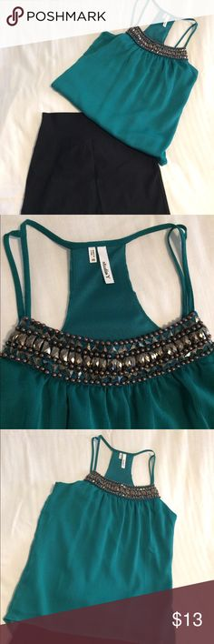 Studio Y Teal Top Teal dressy t-back, spaghetti strap tank with bronze tone beading, longer tail in back. Hangs and flows beautifully.  Only wore once. 100% polyester, hand wash only. Studio Y Tops Blouses