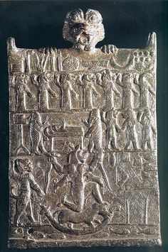Neo-Assyrian apotropaic bronze plaque showing a sick person attended by two  fish-apkallu and a row of evil, disease-causing demons. 0645a44c622a