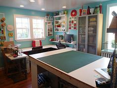 I love this sewing room! I love the cutting table, and the three section sewing desk. It would hold my serger, my embroidery machine, and my sewing machine! And then the cabinet to hold larger folds of material.