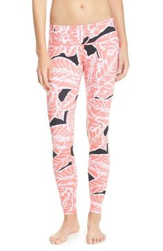 Adding a bright and fun touch to the workout gear with these pink palm print leggings.