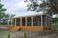 Texas Hill Country cottage by Kanga Room Systems, 480 sf of interior space (approx. 16x30) and 432 feet of porches. Includes kitchen, bath, living room and loft. Lots of pics on this site.