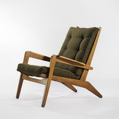Pierre Guariche; #FS105 Oak Armchair for Free Span, 1950.