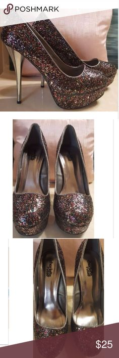 "Charlotte Russe Glitter Sz 9 Platform Stilettos You are purchasing a very good condition pair of women's size 9 Charlotte Russe Glitter Stiletto Heels Pumps Platform style, 5 1/2"" heel, sparkly mainly purple and pink glitter, mirrored like heel. Charlotte Russe Shoes"
