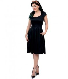Dance divinely in this black sweetheart swing dress from Unique Vintage! With a charming retro shape that boasts a slim-...Price - $62.00-iSIq02XI