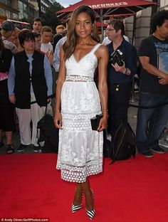 Summer style: The low-cut number made the most of Naomie's slim figure, accentuating her w...