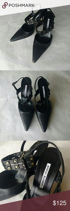 Fierce Manolo Blahnik Black Gold Slingback Heels Totally unique and gorgeous!  Classic style, black slingback pumps with gold rivet detail on cross-foot strap.  Non-slip pads on soles, super light water stain and a tiny bit of scuffing on some of right shoe,  see last photo for details.  Gorgeous, excellent used condition. No box or dust bag.  Euro size 40 = US size 10.  Heel is 4 inches high.  No lowball offers, please! No trades. Manolo Blahnik Shoes Heels