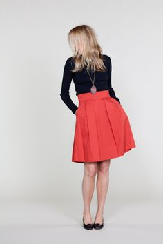 I want this skirt, but in more of a charcoal color. But red will do.    I Love pocket skirts & dresses.