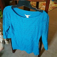 Blue lace overlay top. 3/4 sleeve. Fitted more than I thought. This is a reposh. Too small for me fits more like an 8 Banana Republic Tops Blouses