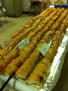 Feed a crowd with table length hoagies! Just cut off the ends of Italian bread & arrange end to end. Big party hit!