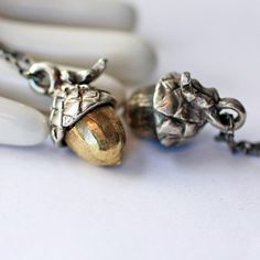 Tiny Acorn Pendant Sterling Silver and Brass on custom cord, via Etsy.