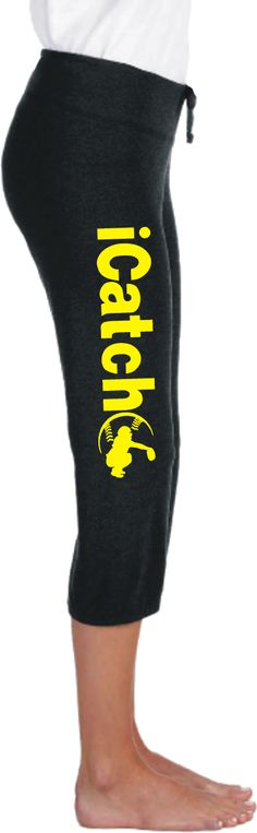 Fastpitch Softball iCatch Silhouette Leg Print Capri Scrunch Pant. From our softball player silhouette iSeries, this classic Bella Capri pant features yellow iCatch printed down the right leg with a softball catcher silhouette nestled in softball seams. Printing on right leg so it reads upright while in sitting position