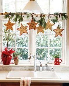 Twig rod + greens + ornaments,etc = cute kitchen window 'curtain'