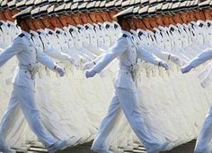 What looks like a mirror effect is actually the military marching in perfect unison.