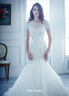 Mermaid wedding dress with chemical lace and tulle. Detailed beadings give this…