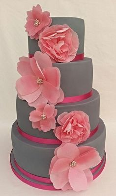 Instead of rice paper flowers, I'd put pink Peony sugar flowers on this cake.