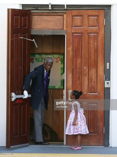 A young lady waits for the doors to open at Emanuel African Methodist Episcopal Church as it is opened for a Sunday service after a shooting at the church killed nine people on June 21, 2015 in Charleston, South Carolina.
