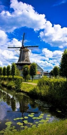 I have ALWAYS wanted to go to the Netherlands & see the fields of tulips & the windmills! The Salamander windmill on the Vliet canal in Leidschendam, South Holland, Netherlands Places Around The World, Oh The Places You'll Go, Travel Around The World, Places To Travel, Places To Visit, Wonderful Places, Beautiful Places, Simply Beautiful, Amazing Places