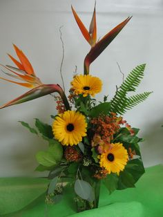 Bright tropical vase arrangement! Brings some paradise home to you!