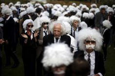 Benny Wasserman 81, stands with others to establish a Guinness world record for the largest Einstein gathering