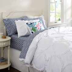 white frilled duvet cover decorated with colourful pillows - Google Search
