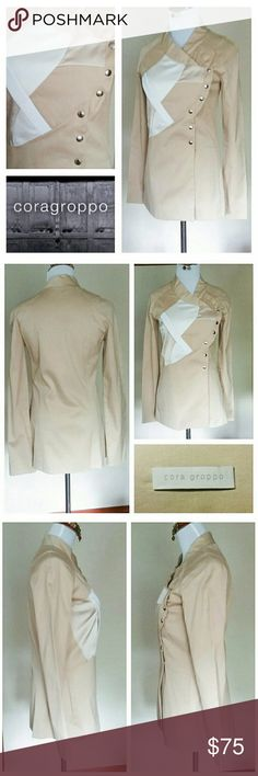 "Argentina's Cora Groppo Asymmetrical Tan Blazer From edgy Argentinian designer Cora Groppo is this asymmetrical tan, beige, & white colorblock jacket. There are snap buttons and a slide pocket on both sides even with the seams.  It is made from 98% cotton & 2% spandex and can be washed in cold. It is listed as size EU 38, ARG 38, USA S.  The approximate measurements across are: shoulder to shoulder 16"", bust 16 1/2"", waist 15"", hips 16 1/2"", base hem 19"". The approximate arm length is 24""…"