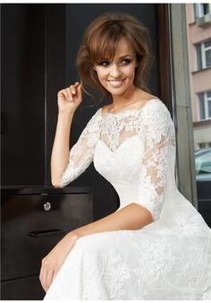 lace sleeves; three quarter sleeves; sweetheart bodice; off the shoulder lace top; illusion top; a-line; fitted; romantic wedding gown; traditional wedding dress