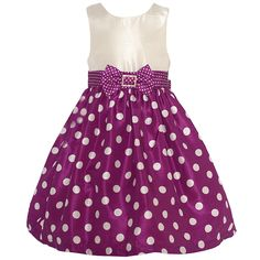 Trendy dress with a fitted bodice and a flared voluminous skirt from designer Mia Juliana. The dress has a sleeveless ivory bodice and a wine ivory polka dotted pattern on the skirt. The cute bow at the waist has a rhinestone accented brooch attached. Zip