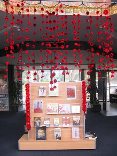 Look at this awesome way to decorate your classroom or child's bedroom this Remembrance Day. String a bunch of hand crafted poppies to fishing line, twine, string, etc. hang from the ceiling and presto! Remembrance Day Activities, Remembrance Day Poppy, School Displays, Classroom Displays, Art For Kids, Crafts For Kids, Ww1 Art, Library Book Displays, Library Ideas