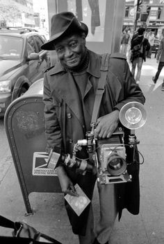 filmwasters:  Louis Mendes Outside B:  Mr. Louis Mendes, famed street portrait artist.  After taking my portrait, he let me take a photo or two of him.  We started talking about black and white, and I found out he's a Tri-X man.  I shoot tons of HP5+, but maybe I'll give Tri-X another shot. Camera: Nikon FE2 w/ 24mm f/2.8 lens. Film: Agfa APX 400 in Rodinal
