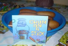 """Spongebob Party Food, Corndogs    I can't imagine the adults feeling so comfortable eating this... for some reason this is one of those foods that becomes """"kiddish"""" and adults are less likely to just grab and eat. But-- cute for the kids, and the adults that WILL eat them- like my husband. Ha."""