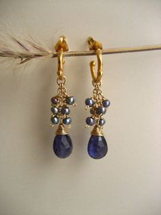 Faceted iolite briolettes and blue freshwater pearl baby hoop earrings by ElfiRoose on Etsy https://www.etsy.com/listing/100130188/faceted-iolite-briolettes-and-blue