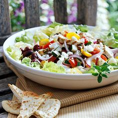 Just a little feta cheese and olive give great fresh flavor to this main-dish chicken salad, which is served with a low-fat cucumber dressing.