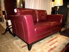 Macy's leather loveseat in a deep wine color. Such beautiful lines! Ideal for a contemporary style home. At posting, we have another…