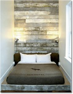 barnboard wall and platform bed - look we're working on,  wish we could go that high though