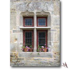 Fenêtre à meneaux restaurée sans démontage