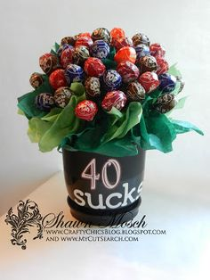 Tootsie Pop bouquet for a 40th birthday gift. Step by step tutorial on how to put it together