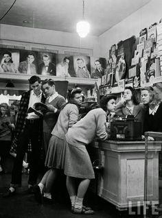 Group of teenagers listening to 45 rpm. records as they shop for the latest hits at a record store, 1944