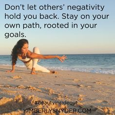Don't let others' negativity hold you back. Stay on your own path, rooted in your goals.