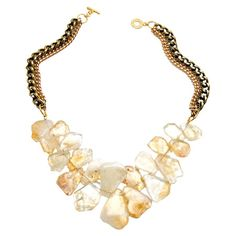 Make a statement with this bold necklace, showcasing an array of citrine crystals on a chunky gold-plated chain.  Product: Neckl...