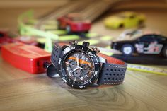 Adrenaline is at full throttle with this race-inspired watch. Lead the field in fashion as well as technology with this sporty, 1/5 second chronograph featuring Eco-Drive technology.  Choose from a stainless steell bracelet, or a soft-touch strap with contrast stitching backed with brightly-colored nylon.  Available at ASHLEY'S Distinctive Jewelry & Gifts, 555 Day Hill Road, Windsor  860-298-9542