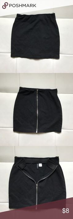 DIVIDED Black Zipper-back Mini Skirt DIVIDED Black Zipper-back Mini Skirt is the perfect addition to your Girls Night Out wardrobe! Ultra versatile, style it under a super-sheer slip or pair it with a cute tee and sneakers - the options are unlimited with this edgy take on a closet classic! note: the label says us 6, but I am normally a 4 and this fits like a body con. Recommended to sizes 2 and under for a looser fit, sizes 4+ for body-con fit. Divided Skirts Mini