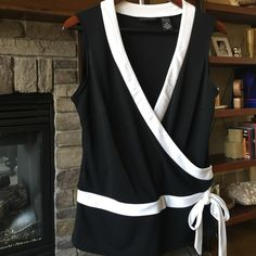 "NY&C blouse  Beautiful black and white New York and Company blouse. 100% polyester. 23.5"" long, 17"" wide across chest, with much stretch and is a wrap shirt at chest area. The shirt looks like it can completely open at bottom tie, but it does not. Shirt has a really nice weight to it. Perfect condition! New York & Company Tops Blouses"